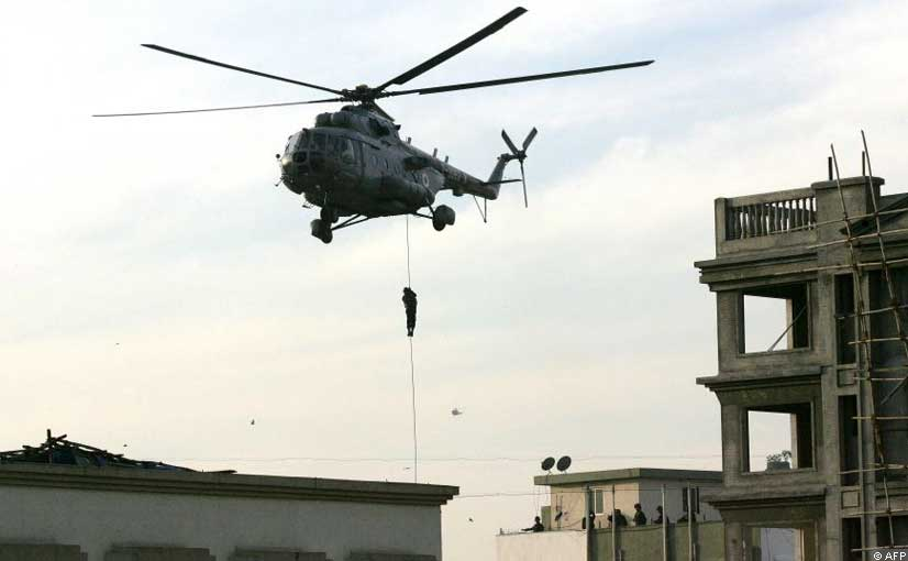 Commando being dropped by a chopper