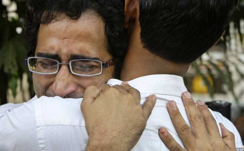 A grieving relative of a terrorist attack victim is consoled outside the St. Georges Hospital in Mumbai. Authorities estimate 172 people died in the attacks and hundreds more were injured.