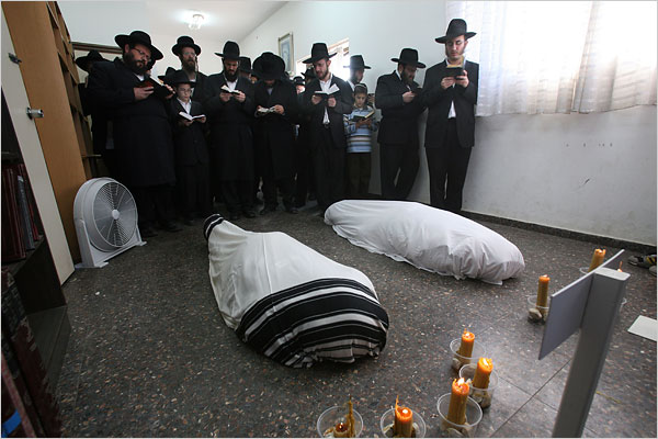 In Israel, the six people killed at the Chabad-Lubavitch mission in Mumbai were buried. The bodies of the young couple who ran the center, Rabbi Gavriel Holtzberg and his wife, Rivkah, were wrapped in prayer shawls and shrouds as family and members of their religious community prayed over them. The Holtzbergs' 2-year-old son, Moshe, was rescued from the center unharmed on Thursday.