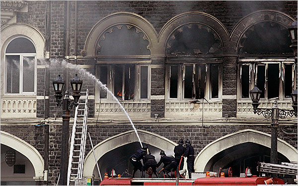 Members of Indian fire brigade try to douse the fire at the Taj Mahal Hotel after the end of a gun battle between Indian military and militants inside the hotel in Mumbai, India, Saturday, Nov. 29, 2008. Indian commandos killed the last remaining gunmen holed up at the luxury Mumbai hotel Saturday, ending a 60-hour rampage through India's financial capital by suspected Islamic militants that killed people and rocked the nation. (AP Photo/Altaf Qadri)