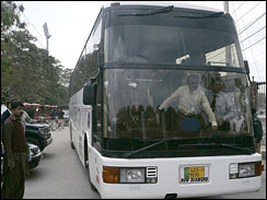 A bus which was carrying Sri Lankan cricketers is seen with bullet holes outside the Gaffafi stadium after it came under attack by a group of gunmen in Lahore, Pakistan on March 3, 2009. (AP Photo/K.M. Chaudhry)